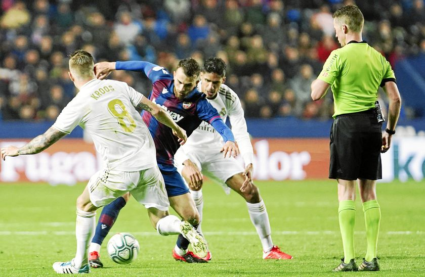 Levante's Borja Mayoral, second left, and Real Madrid's Toni Kroos, left, challenge for the ball during the Spanish La Liga soccer match between Levante and Real Madrid at the Ciutat de Valencia stadium in Valencia, Spain, Saturday, Feb.22, 2020. (AP Photo/Alberto Saiz)