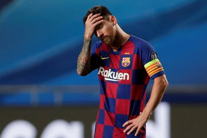 FILE PHOTO: Barcelona's Lionel Messi looks dejected during Champions League quarter-final v Bayern Munich