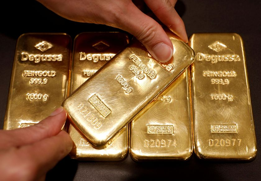 FILE PHOTO: An employee shows gold bullions at Degussa shop in Singapore