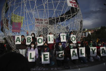 """FILE - In this Sept. 28, 2020 file photo, women hold letters forming the phrase """"Legal Abortion Now"""" during an abortion-rights protest in Quito, Ecuador. The South American country's constitutional court ruled on Wednesday, April 28, 2021, in favor of decriminalizing abortion in the case of rape.(AP Photo/Dolores Ochoa, File)"""