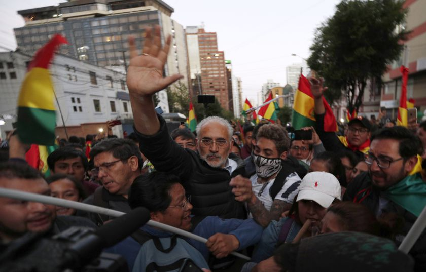 FILE - In this Oct. 22, 2019 file photo, Bolivia's opposition presidential candidate Carlos Mesa waves to supporters during an anti-government march in La Paz, Bolivia. A main candidate, Mesa draws much of his support from Bolivia's urban, more affluent population. (AP Photo/Juan Karita, File)