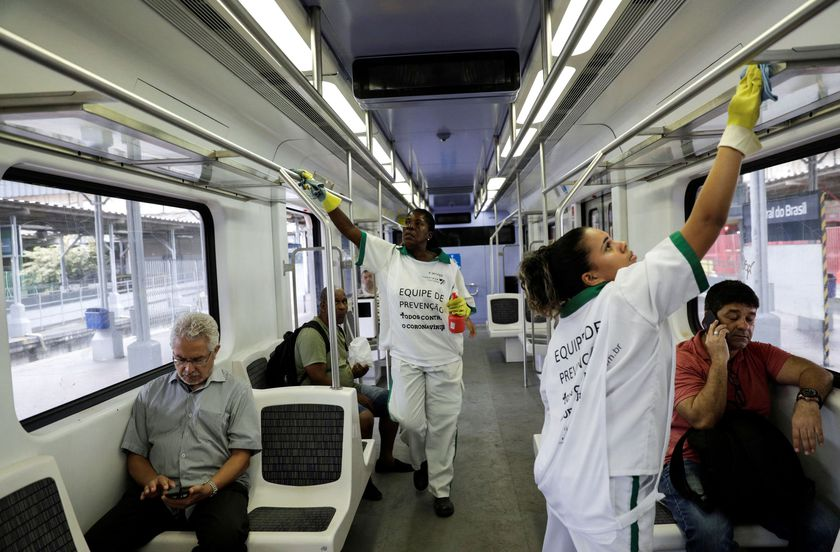 Cleaners work on the disinfection of a train at Central do Brasil train station as a measure on coronavirus disease (COVID-19) in Rio de Janeiro