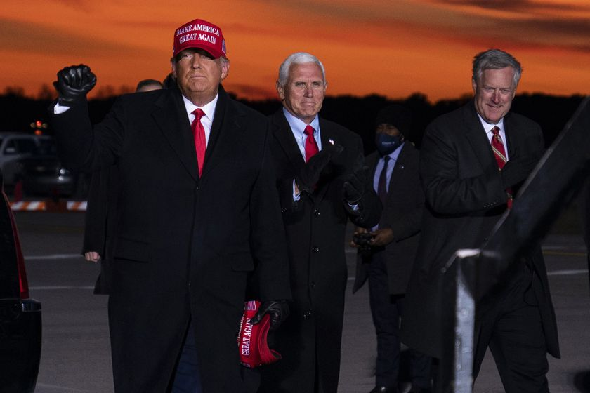 President Donald Trump and Vice President Mike Pence arrive for a campaign rally at Cherry Capital Airport