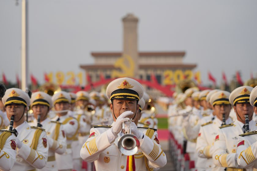 FILE - In this July 1, 2021, file photo, a military band rehearses for a ceremony to mark the 100th anniversary of the founding of the ruling Chinese Communist Party at Tiananmen Gate in Beijing. Chinese fighter jets, anti-submarine aircraft and combat ships conducted assault drills near Taiwan on Tuesday, Aug. 17, 2021, with the People's Liberation Army saying the exercise was necessary to safeguard China's sovereignty. (AP Photo/Ng Han Guan, FIle)