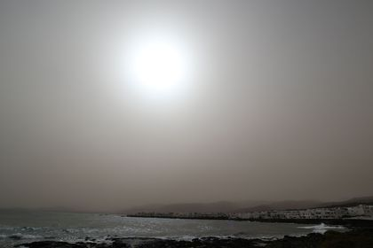 A hazy sun is seen through a sand storm known locally as the La Calima, off the coast of Punta Mjueres, Lanzarote