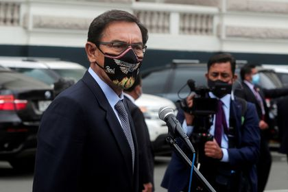 FILE PHOTO: Peru's President Martin Vizcarra addresses the media outside Congress as he faces a second impeachment trial over corruption allegations, in Lima, Peru November 9, 2020. REUTERS/Sebastian Castaneda/File Photo