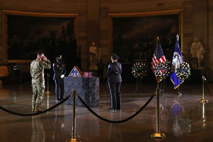 A member of the National Guard who served with late U.S. Capitol Police Officer Brian Sicknick pays his respects in the Capitol Rotunda at the U.S. Capitol in Washington, U.S., February 2, 2021. REUTERS/Leah Millis/Pool