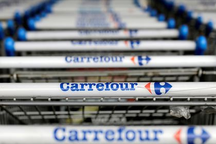 FILE PHOTO: The logo of French retailer Carrefour on shopping trolleys . REUTERS/Paulo Whitaker/File Photo