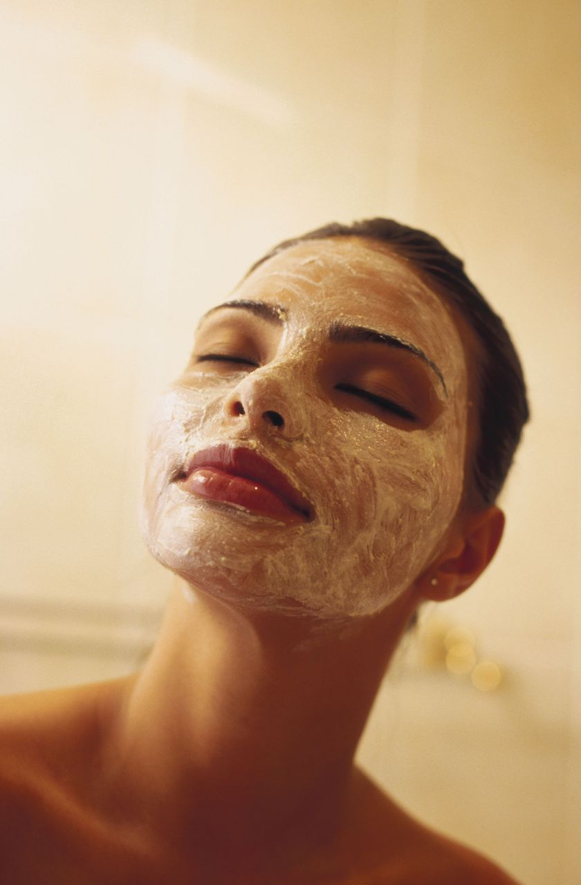 Close-up of a young woman with a facial mask