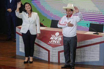 Peru's right-wing candidate Keiko Fujimori and socialist candidate Pedro Castillo wave at the end of their debate ahead of the June 6 run-off election, in Arequipa, Peru May 30, 2021. REUTERS/Sebastian Castaneda/Pool