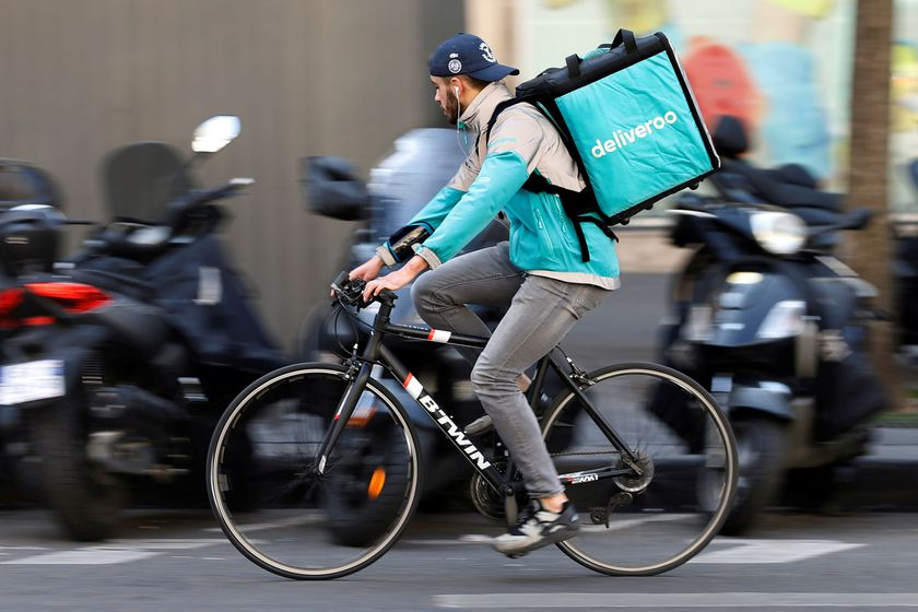 FILE PHOTO: A cyclist rides a bicycle as he delivers a food order for Deliveroo, an example of the emergence of what is known as the 'gig economy', in Paris
