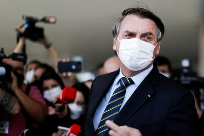 FILE PHOTO: Brazil's President Jair Bolsonaro is seen after a meeting with Brazil's Lower House Arthur Lira at the Planalto Palace, in Brasilia, Brazil, March 25, 2021. REUTERS/Ueslei Marcelino/File Photo
