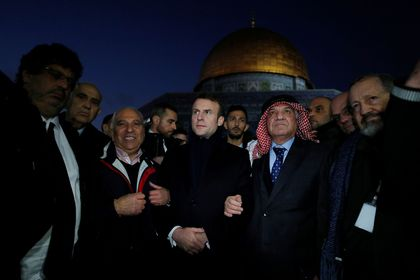 The Dome of the Rock is seen in the background as French President Emmanuel Macron visits the compound housing al-Aqsa mosque known to Muslims as Noble Sanctuary and to Jews as Temple Mount, in Jerusalem's Old City