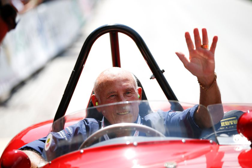 FILE PHOTO: Stirling Moss waves to spectators as he sits in his 1955 Ferrari 750 Monza during the Ennstal Classic rally in this 2013 file photo