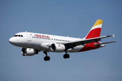 FILE PHOTO: An Airbus A319 aircraft, operated by Iberia, lands at Orly Airport near Paris