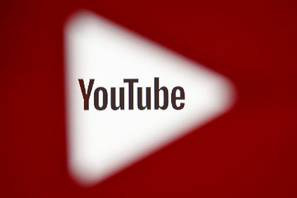 FILE PHOTO: A 3D-printed YouTube icon is seen in front of a displayed YouTube logo in this illustration