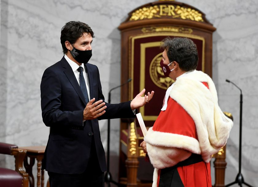 Canada's Prime Minister Justin Trudeau speaks with Chief Justice Richard Wagner as they wait for the throne speech in the Senate chamber in Ottawa, Ontario, Canada September 23, 2020.  Adrian Wyld/Pool via REUTERS.