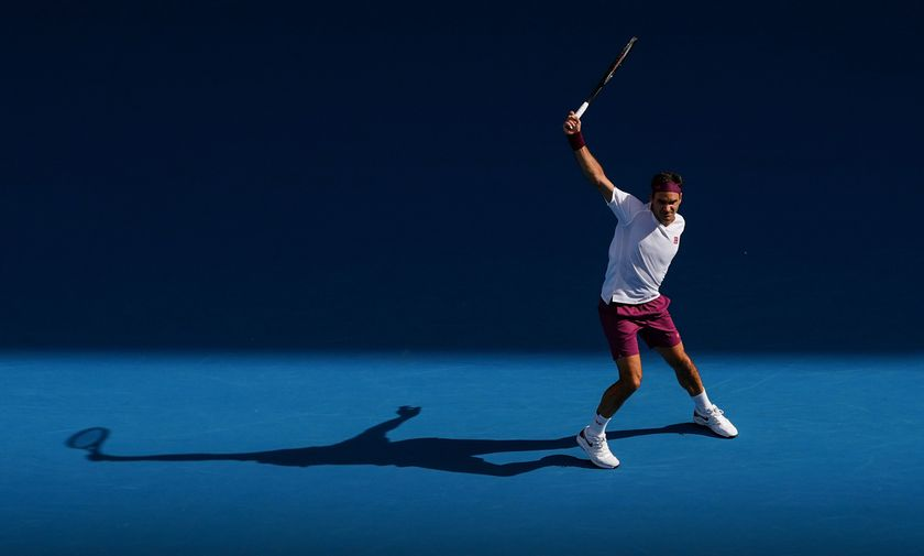 Roger Federer of Switzerland plays a shot during his fifth round match against Tennys Sandgren of the USA on day nine of the Australian Open tennis tournament at Rod Laver Arena in Melbourne, Tuesday, January 28, 2020. (AAP Image/Scott Barbour) NO ARCHIV