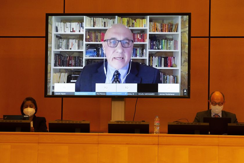 """FILE - In this Feb. 12, 2021, file photo, Thomas Andrews, UN Special Rapporteur on the human rights situation in Myanmar is displayed on a screen as he addresses his statement during the Human Rights Council special session on """"the human rights implications of the crisis in Myanmar"""" at the European headquarters of the United Nations in Geneva, Switzerland. At least one-quarter of the people in Myanmar's smallest state have been forced to flee their homes because of combat with the military junta that seized power in February, raising fears of a possible humanitarian tragedy including thousands of civilian deaths, the U.N. expert Andrews said Wednesday, June 9.(Salvatore Di Nolfi/Keystone via AP, File)"""