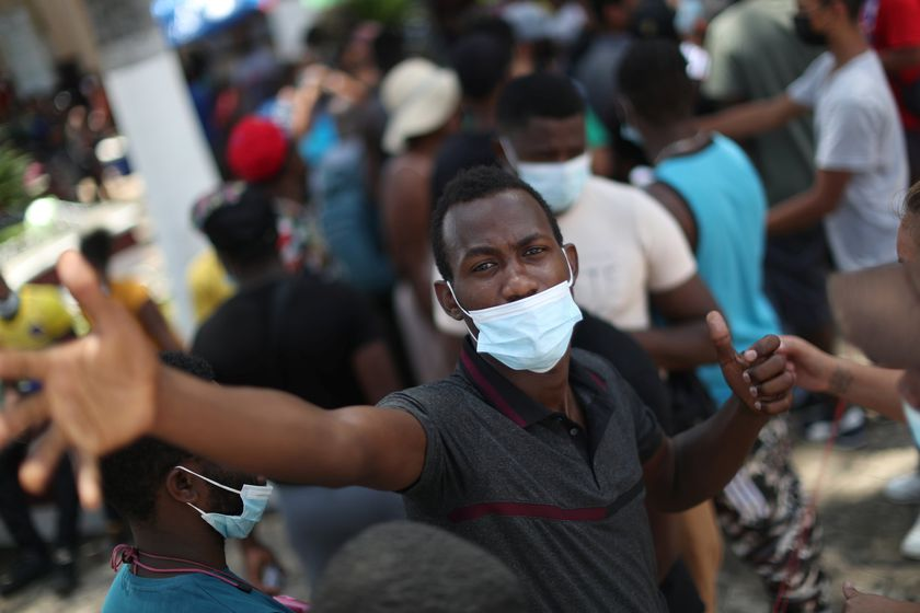 A migrant from Haiti gestures as he waits to deliver documents to representatives of social organizations to regularize his immigration status at Benito Juarez square in Tapachula, in Chiapas state, Mexico September 14, 2021. REUTERS/Edgard Garrido