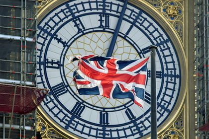 FILE PHOTO: British Union Jack flag flies in front of the clock face of Big Ben in London