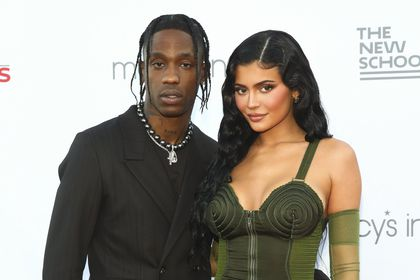 Recording artist Travis Scott, left, and Kylie Jenner, right, attend the 72nd annual Parsons Benefit presented by The New School at The Rooftop at Pier 17 on Tuesday, June 15, 2021, in New York. (Photo by Andy Kropa/Invision/AP)