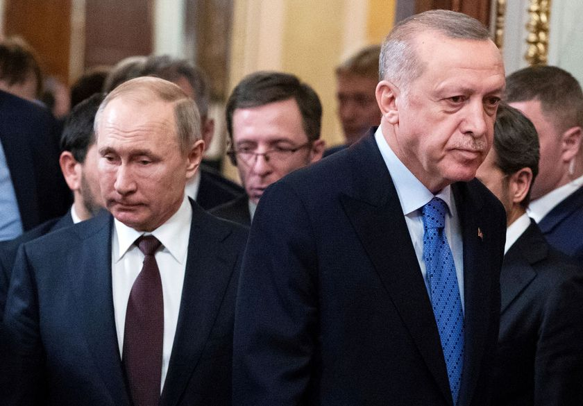 FILE PHOTO: Russian President Vladimir Putin and Turkish President Tayyip Erdogan arrive for a news conference following their talks in Moscow, Russia March 5, 2020. Pavel Golovkin/Pool via REUTERS//File Photo