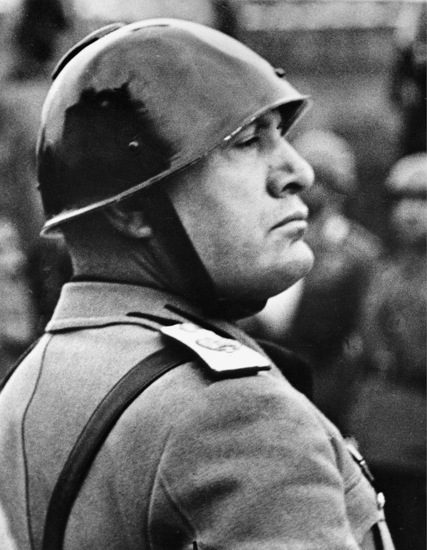 Italian Premier-dictator Benito Mussolini reviews troops before the national Italian monument in honor of the 68th birthday of King Victor Emmanuel in Rome, Italy, Nov. 11, 1937.  (AP Photo)