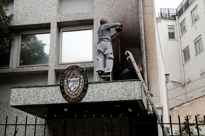 Experts inspect the damage at the Cuban embassy following an overnight petrol bomb attack on its building, in Paris, France July 27, 2021. REUTERS/Benoit Tessier