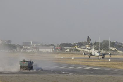 A street sweeper truck clears volcanic ash from the runway of the  Jose Joaquin de Olmedo international airport in Guayaquil, Ecuador, Sunday, Sept. 20, 2020. An intense volcanic ash fall was registered in various parts of Ecuador due to an eruption of Sangay Volcano, located in the Amazon area of the country. (AP Photo/Angel Dejesus)
