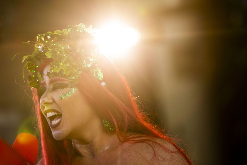 """A woman performs in the """"Desliga da Justica"""" block party in Rio de Janeiro, Brazil, Sunday, Feb. 14, 2021. The party was broadcast live on social media for those who were unable to participate in the carnival due to COVID restrictions after the city's government officially suspended Carnival and banned street parades or clandestine parties. (AP Photo/Bruna Prado)"""
