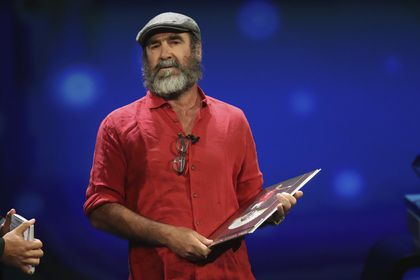 [French former soccer star Eric Cantona receives the UEFA President's Award during the Champions]
