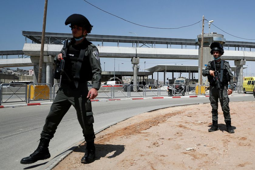 Israeli forces work at the scene of an incident at Qalandia checkpoint in the Israeli-occupied West Bank