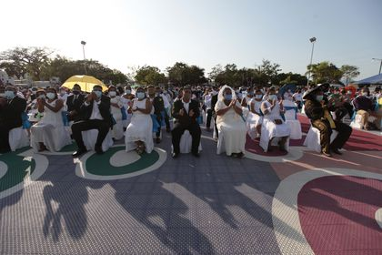 "Couples sit together during a mass wedding in Managua, Nicaragua, Sunday, Feb 14, 2021. Around 400 couples said ""I do"" on Valentine's Day during the mass wedding. (AP Photo/Diana Ulloa)"