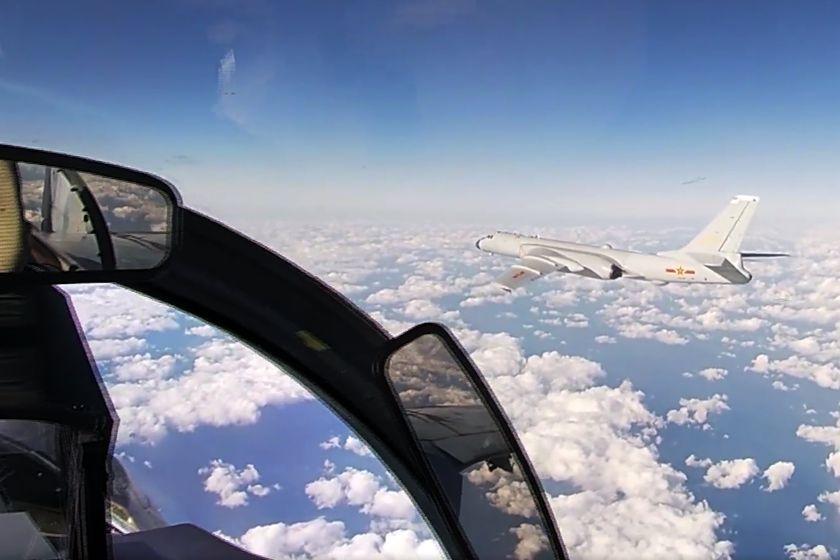 In this photo taken from a video distributed by Russian Defense Ministry Press Service, on Tuesday, Dec. 22, 2020, a Chinese H-6K strategic bomber flies during a joint patrol mission over the Western Pacific. Russian and Chinese bombers flew a joint patrol mission over the Western Pacific Tuesday in a show of increasingly close military ties between Moscow and Beijing. The Russian military said that a pair of its Tu-95 strategic bombers and four Chinese H-6K bombers flew over the Sea of Japan and the East China Sea. (Russian Defense Ministry Press Service via AP)