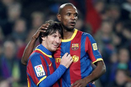 FILE PHOTO: Barcelona defender Abidal embraces teammate Messi after a goal against Atletico Madrid during their Spanish first division soccer match in Barcelona