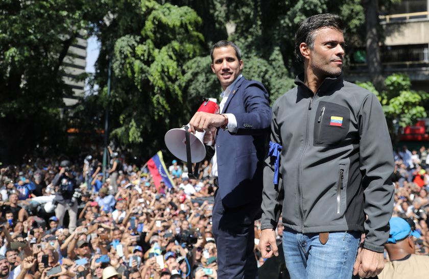Venezuelan opposition leader Juan Guaido, who many nations have recognised as the country's rightful interim ruler and fellow opposition leader Leopoldo Lopez address a crowd of supporters in Caracas.