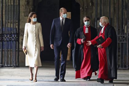Britain's Prince William and Kate, Duchess of Cambridge with Dean of Westminster The Very Reverend Dr David Hoyle, right, and Paul Baumann, Receiver General and Chapter Clerk arrive for a visit to the vaccination center at Westminster Abbey, London, Tuesday, March 23, 2021 to pay tribute to the efforts of those involved in the Covid-19 vaccine rollout. The U.K. is marking a national day of reflection Tuesday a year after British Prime Minister Boris Johnson first announced that the country would go into lockdown to slow the fast-spreading coronavirus. (Aaron Chown/Pool Photo via AP)