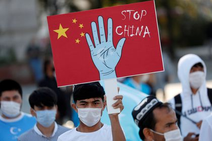 FILE PHOTO: Ethnic Uighur demonstrators take part in a protest against China, in Istanbul, Turkey October 1, 2020. REUTERS/Murad Sezer/File Photo