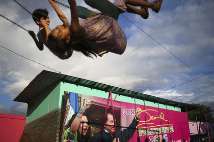 FILE - In this Nov. 4, 2016 file photo, children swing in a park next to an election billboard for President Daniel Ortega and his running mate, his wife, Rosario Murillo in Managua, Nicaragua. In June 2021, amid a weekslong clampdown to obliterate nearly every hint of opposition, Ortega ordered the arrest of Hugo Torres, a revered guerrilla in the fight against right-wing dictator Anastasio Somoza. In 1974, Torres had taken a group of top officials hostage, then traded them for the release of imprisoned comrades, among them, Daniel Ortega. (AP Photo/Esteban Felix, File)