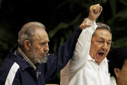 FILE - In this April 19, 2011 file photo, Fidel Castro, left, raises the hand of his brother President Raul Castro as they sing the international socialism anthem during the 6th Communist Party Congress in Havana, Cuba. For most of his life, Raul Castro played second-string to his brother, but for the past decade, it's Raul who's been the face of communist Cuba. On Friday, April 16, 2021, Raul Castro formally announced he'd step down as head of the Communist Party, leaving Cuba without a Castro in an official position of command for the first time in more than six decades. (AP Photo/Javier Galeano, File)