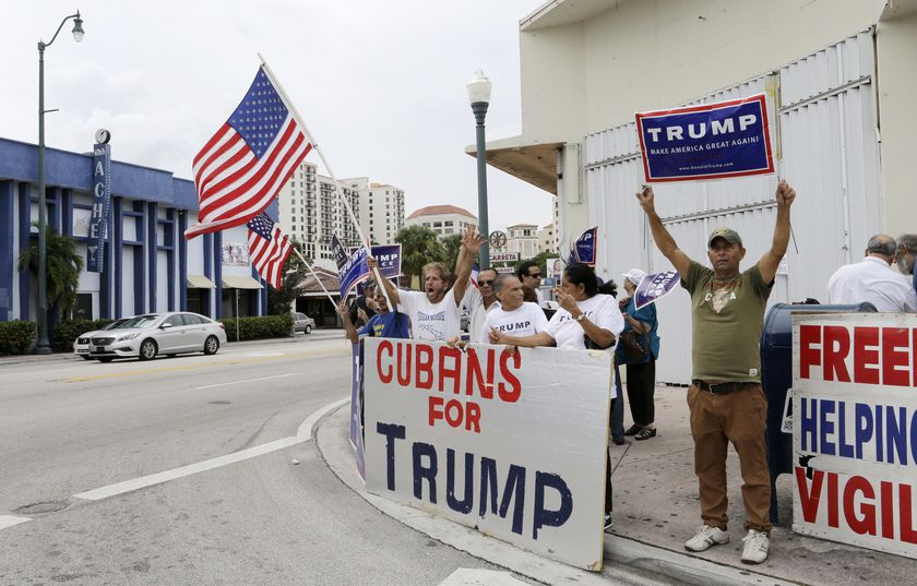 FILE - In this Oct. 28, 2016 file photo, Cuban-Americans chant pro-Trump slogans as they show their support for Republican presidential candidate Donald Trump, in Miami. According to a poll released on Oct. 2, 2020 from Florida Internacional University, the majority of Cuban-Americans living in South Florida support the economic embargo and the hard-line policy against Cuba implemented by Trump, but they also agree with measures that promote some engagement.  (AP Photo/Alan Diaz, File)