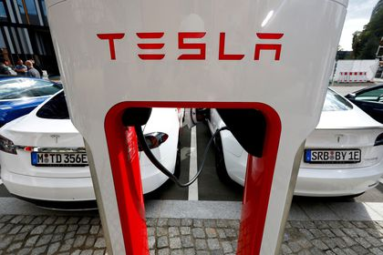 FILE PHOTO: The company logo of Tesla cars is seen on the V3 supercharger equipment during the presentation of the new charge system in the EUREF campus in Berlin, Germany September 10, 2020. REUTERS/Michele Tantussi/File Photo