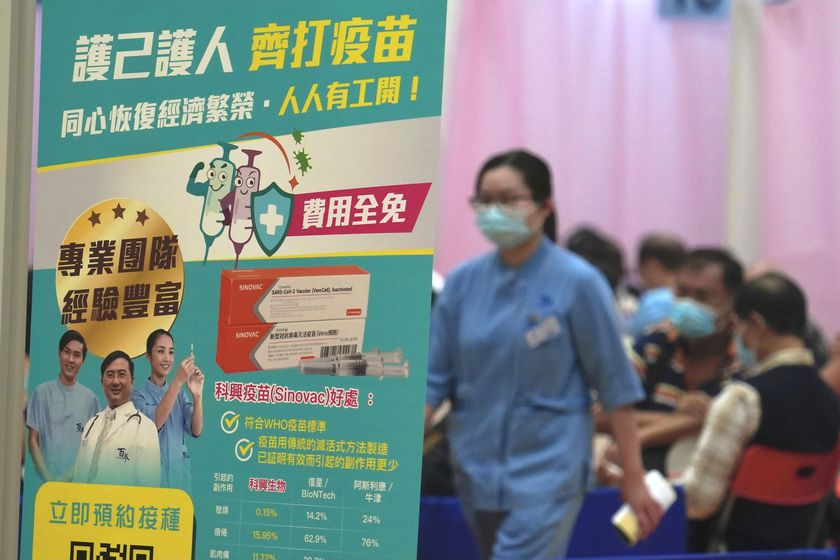 People wait to receive China's Sinovac COVID-19 coronavirus vaccine at a community vaccination centre in Hong Kong, Friday, Feb. 26, 2021. Hong Kong began administering its first COVID-19 vaccines to the public Friday, kicking off its program offering free vaccinations to all 7.5 million residents. (AP Photo/Kin Cheung)