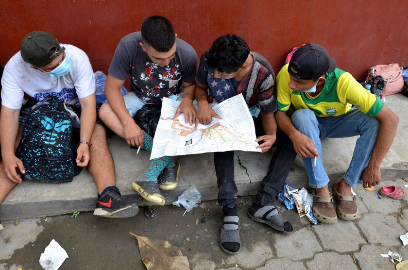 FILE PHOTO: A group of Honduran migrants who are trying to reach the U.S. , look at a Central America and Mexico map outside a migrant shelter as they wait to move towards the Guatemala and Mexico border, in Tecun Uman, Guatemala October 3, 2020. REUTERS/Jose Torres//File Photo