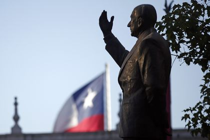 FILE - In this Jan. 30, 2019 file photo, a statue of the late President Eduardo Frei Montalva stands in front of the La Moneda Palace, in Santiago, Chile. A court in Santiago has revoked on Monday, Jan. 25, 2021, a ruling that found 4 doctors and two former security agents of the regime of dictator Augusto Pinochet guilty for the murder of former president Frei in 1982. (AP Photo/Luis Hidalgo, File)