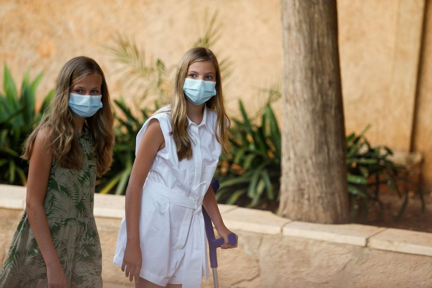 Spain's Princess Leonor and Infanta Sofia walk in the streets of the village of Petra