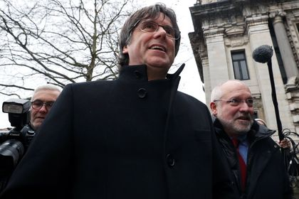 Former Catalan leader Carles Puigdemont arrives at the Justice Palace in Brussels