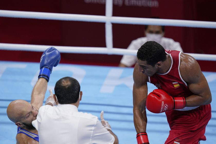 Enmanuel Reyes Pla, right, punches Kazakhstan's Vassiliy Levit during their men's heavyweight 91-kg boxing match at the 2020 Summer Olympics, Tuesday, July 27, 2021, in Tokyo, Japan. (AP Photo/Frank Franklin II)