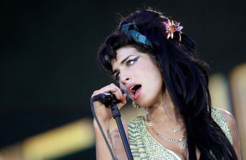 """FILE PHOTO: British singer Amy Winehouse performs during the """"Rock in Rio"""" music festival in Arganda del Rey, near Madrid, July 4, 2008. REUTERS/Juan Medina/File Photo"""
